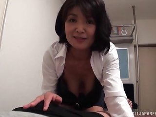 Mature redhead Japanese housewife gives her husband a great blowjob
