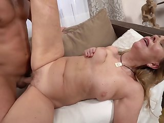 A hot trull granny is getting fucked by a horny younh man