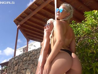 Two sexy bikini girls are waiting for your admiration and attention