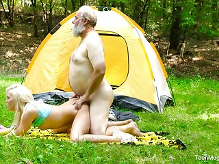Staggering blonde camping girl Lovita Fate rides dick of gaffer outdoors