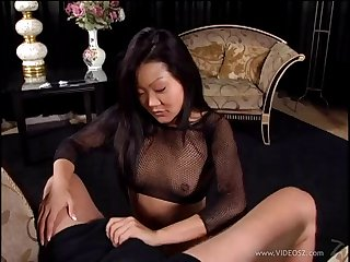 Seductive Asian cougar near fishnet stockings awarding her guy a well done handjob near a reality shoot